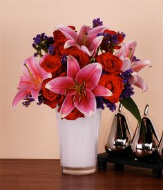 ELEGANCE    Rose, Lily  Violet Statice Flowers   They say beauty is in the eye of the beholder. She is that special someone who exudes that elegance. Send her this bouquet of roses, lilies and statice to let her know the reasons why you love her!