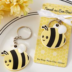 Celebrate the arrival of your sweet little honeybee with these adorable favors. The Sweet As Can Bee! Baby Bee Keychain favor features an adorable rubber baby bee with three dimensional details. The sweet baby bumblebee hangs from a metal key ring that is tied with white satin ribbon on a pale yellow presentation card printed to look like a honeycomb. The baby bee keychain is the perfect complement to any baby shower as the bright colors work well for both genders. The baby bee keychain ...