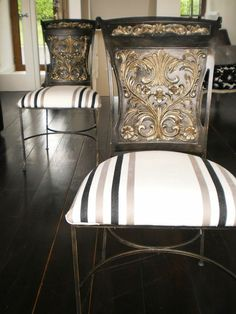 Resin and iron chairs with hand-painted reliefs and Casamance fabric.