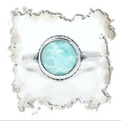 Sterling silver and larimar ring. Sample ring is a size 7 but can be made to order. Sterling silver with large, beautiful larimar cabochon. Very simple and looks great stacked with multiple silver bands. Handmade Jewelry Rings