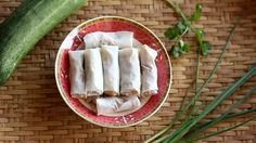 Setting mint leaves on fresh Spring roll, Vietnamese food, vintage style Food concept footage