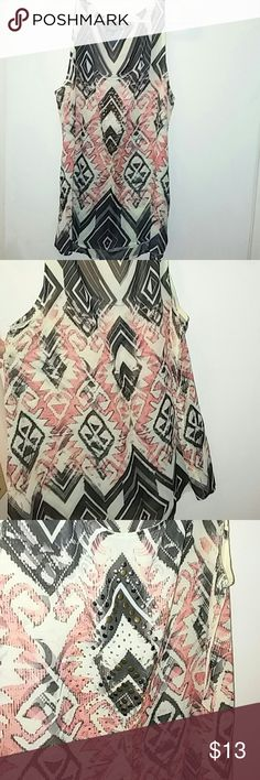 Pretty studded near sheer tribal tank Daytrip Ivory, black and peach tribal sleeveless near sheer blouse.  Studded front.  Hi-lo. Size large.  100%poly.   Bust 42 inches.   Length 29 in front, 31 in back. Daytrip Tops