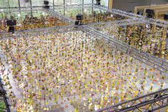 London-based artist Rebecca Louise Law is revered for her hanging flower installations, which have appeared everywhere from New York's Times Square to the Onassis Culture Centre in Athens. In 2014, we admired her exhibit at London's Garden Museum, where she strung over 4,600 blooms from the ceiling in an exploration of the relationship between flora and fashion. But Law's latest creation might just be her most jaw-dropping yet—in the atrium of the Bikini Berlin shopping mall, she has…