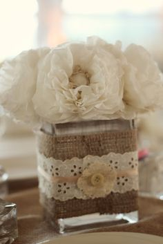 More centerpiece ideas! Glass wrapped with burlap, lace, ribbon and paper flowers.