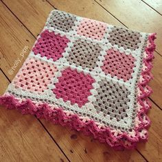 Crochet - solid colour granny squares in pink and grey, with border pattern from Dada's Place