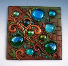 Autumn Breeze Mosaic Art Tile made with glass and polymer clay in earthy shades of gold, green and brown.
