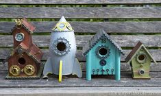 Steampunk Birdhouses. Plain wooden bird houses painted and decorated with steampunky gears and metal flea market finds!