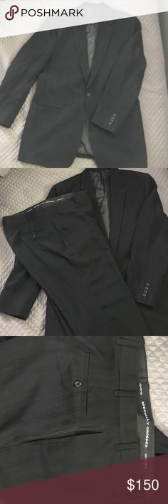 Men tailored black suit  made in Dubai This handsome men's suit was tailored made in Dubai. Only worn once and dry cleaned. Please notice on the label the cleaners mark. Tailored Made Suits & Blazers Suits