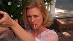 When Betty took aim at her neighbor's pigeons mid smoke. | 13 Moments When Betty Draper Didn't Give A F%$k