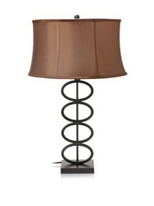 Lighting Enterprises Circles Lamp, Mission Bronze by Lighting Enterprises. $72.17. T-1554/1511 Lampshade: Cream Brussels Linen Hardback Features: -Table lamp.-Mission bronze rings. Options: -Available in coffee colored sewn or cream linen hardback shade. Assembly Instructions: -Assembly required. Dimensions: -17'' Table lamp dimensions: 28'' H x 17'' W.-18'' Table lamp dimensions: 28'' H x 18'' W. Warranty: -Manufacturer provides 1 year warranty on electrical prod...