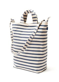 "A tote bag in durable recycled cotton canvas duck. Two handles and 40"" adjustable strap, to carry in hand or over shoulder. BAGGU https://baggu.com/shop/duckbag/sailorstripe"