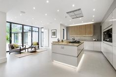 Lovely seating area alongside contemporary kitchen in a renovated 1930's London home