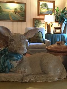 Love , love, love vintage statuary. Concrete deer with a sassy necktie. Bluebonnet oil paintings in background not bad either.   Call us at (903) 597-7421 Online at www.breedlovelandscape.com  #vintage #vintagestatuary #bluebonnets #breedlovelandscape #landscapearchitecture #landscape #architecture #tylertx #tylertexas #tyler #texas