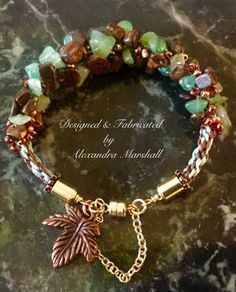"Fall in love with the rich Fall colors in this woven Brown Bronzite and Teal Green Chrysoprase 7"" bracelet by Alexandra Marshall. Accentuated with a copper leaf charm, a brass magnetic clasp and safety chain. $59. To order gift boxed, double click photo."