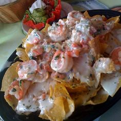 Make our Red Lobster Shrimp Nachos Recipe at home tonight for your family. With our Secret Restaurant Recipe your Shrimp Nachos will taste just like Red Lobster's. Red Lobster Shrimp Nachos Recipe, Seafood Nachos, Lobster Recipes, Seafood Recipes, Mexican Food Recipes, Appetizer Recipes, Cooking Recipes, Shrimp Appetizers, Cheddars Restaurant Recipes