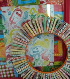 clothespin wreath with scrapbook paper - great for a little girls room!