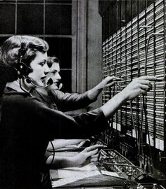 telephone operators, 1950s.  You had to tell the operator the phone number you wanted to call.