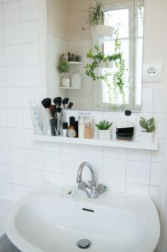 Mount a picture ledge under your mirror to turn a sliver of wall space into storage space for your makeup brushes, fragrances, and more. Small Bathroom Storage, Bathroom Design Small, Bathroom Layout, Simple Bathroom, Bathroom Shelves, Bathroom Ideas, Storage Mirror, Small Bathrooms, Modern Bathroom