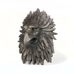 This stern eagle once decorated the door of an Italian palazzo or grand residence. It held a ring in its beak, which was used for knocking. Its feathers are spread out around its stylised head like a flat collar. This type of sculptural door knocker was very popular in Italy from the sixteenth century onward.  http://www.fancyproducts.eu/store/replica-eagle-head-rijksmuseum-collection.html