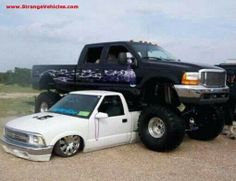 not bein racist or anything but the jacked up is redneck and the small on is mexican