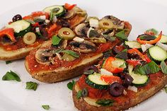 Slices of baked potato stand in for pizza crust in this whole foods plant based vegan potato pizza recipe. Gluten-free, too!