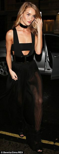 What an entrance: Rosie turned more than a few hears as she rocked up wearing very little...