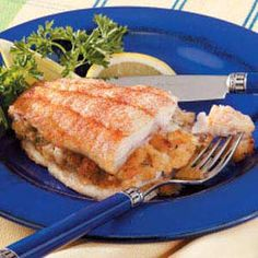 """Crab-Stuffed Catfish Recipe -""""My family was not big on fish.until I made this dish,"""" Joy McConaghy from Moline, Illinois notes. She stuffs catfish fillets with a delicious mixture of crabmeat, cheese, seasoned bread crumbs and mayonnaise. Fish Dishes, Seafood Dishes, Fish And Seafood, Seafood Recipes, New Recipes, Cooking Recipes, Favorite Recipes, Healthy Recipes, Main Dishes"""