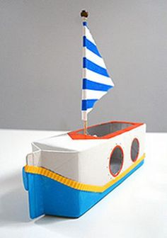 Boot maken van een melkpak. Goedkoop en weer leuk voor de kinderen.  (www.opvoedproducten.nl)