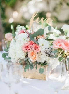 Floral centerpiece wedding table marker / http://www.himisspuff.com/wooden-box-wedding-decor-centerpieces/18/
