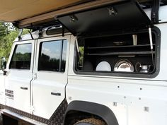 The Front Runner Gullwing window replaces the rear window of a Land Rover Defender allowing easy access to the cargo bay via the side of the vehicle. While built for off-road durability and ease of use, the Front Runner Aluminum Gullwing Window looks smar Landrover Defender, Defender 90, Land Rover Camping, Suv Camping, Range Rover Parts, Jeep Grand Cherokee Zj, Adventure Gear, Adventure Travel, Front Runner