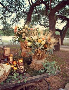 Hay, rustic, pale orange, roses & babies breath. maybe to place around the dance floor or as a smaller scale center piece in the table...