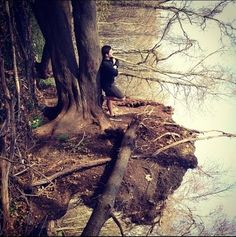 This is not a man standing at a reflective lake.