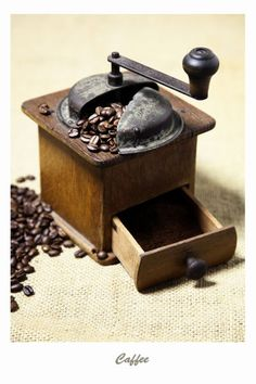 'Kaffeemühle mit Kaffeebohnen Bild - Caffee' von Falko Follert Kunst Poster Shop bei artflakes.com als Poster oder Kunstdruck $16.63