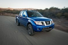 2015 Nissan Frontier Pro 4X Front Three Quarter In Motion 03