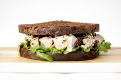 chicken cranberry salad with white truffle aioli and wild arugula on pumpernickel