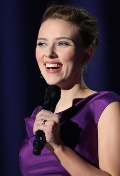 Scarlett Johansson Photos - Actress Scarlett Johansson arrives on stage to present the Nobel Peace Prize Concert 2008 at the Oslo Spektrum on December 11, 2008 in Oslo, Norway. The Norwegian Nobel Committee yesterday awarded the Nobel Peace Prize for 2008 to Martti Ahtisaari for his efforts to resolve international conflicts. Actors Michael Caine and Scarlett Johansson are hosting the gala event which features performances from Diana Ross, operatic quartet Il Divo and Swedish…