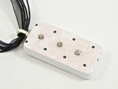 Pink fleur de lis gemstone domino necklace.  $25.00  #wiredboutique