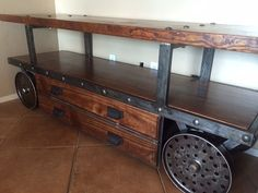 Vintage Industrial TV Console with Salvaged Bowling Alley Wood and Cast Iron Wheels