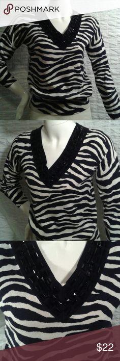 Michael Kors zebra print embellished sweater Fabulous v-neck sweater with black embellishments at neckline. MICHAEL Michael Kors Sweaters V-Necks