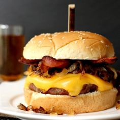 These hamburger patties are soaked in whiskey and garlic, then grilled and topped with bacon, caramelized onions and cheese! Amazing.