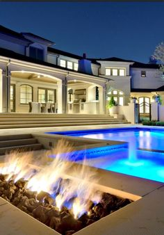Love this exterior..fab pool and fire pit.