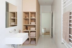 To stay within the budget, the designers decided to forgo natural stone in the bathrooms in lieu of simple vitrified tile. The bathroom isn't without its luxuries, however, as evidenced by the heated towel rail from Hydrotherm.