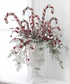 Check out this collection of 36 Impressive Christmas Table Centerpieces and find how to decorate your holiday table. Tie red-and-white peppermint sticks around a vase with a.use candy canes in centerpiece. great idea for the kids table at Christmas d Noel Christmas, Winter Christmas, Christmas Wreaths, Christmas Ornaments, Christmas Candy, Whimsical Christmas, Beautiful Christmas, Outdoor Christmas, Christmas Planters