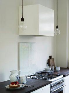 Hidden exhaust, piece of marble oven back splash (reuse old countertops?), dark wood countertops