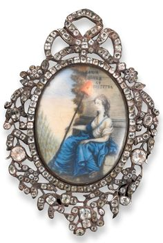 A late 18th Century pendant of French Revolution interest with glazed oval painting of a seated woman, partly bare-chested and wearing a flowing blue and white dress. She holds a Liberty Pole with the red Phrygian cap. With the Masonic motto Amor Honor Et Justica. White paste set ornate frame with pierced foliate decoration and surmounted with a bow.