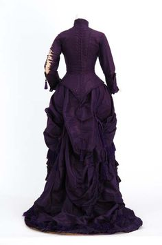 ca. 1880, Royal purple silk taffeta bustled dress. Wedding dress of Anna Malcolm Agnew Davis (Mrs. Cushman K. Davis), attributed to the Christianson sisters, dressmakers of Minneapolis, Minnesota.