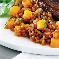 Carrot-Infused Wheat Berries with Butternut Squash - Clean Eating Magazine - Try this side, of cinnamon- and carrot-scented wheat berries with butternut squash, with beef, chicken or fish.