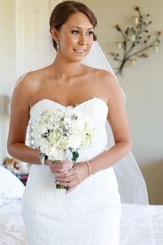 Beautiful bride, white wedding, stunning flowers, THE PERFECT WEDDING. This brides bouquet includes, hydrangea, roses, silver suede and foliage.