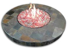 """WARM UP ON THE HOLIDAYS This Oriflamme 42"""" round fire table with Mosaic Santa Fe top includes four color glass, burner cover and 20# propane tank. And who needs elves with the free delivery and set-up?! Priced at $2,299! And ready for immediate delivery while stock supplies last. Special pricing also available on additional sizes and styles. The Patio Store, 1621 Georgia 40, Kingsland, 912.729.1173."""