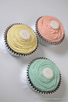 button baby shower cupcakes pink yellow blue
